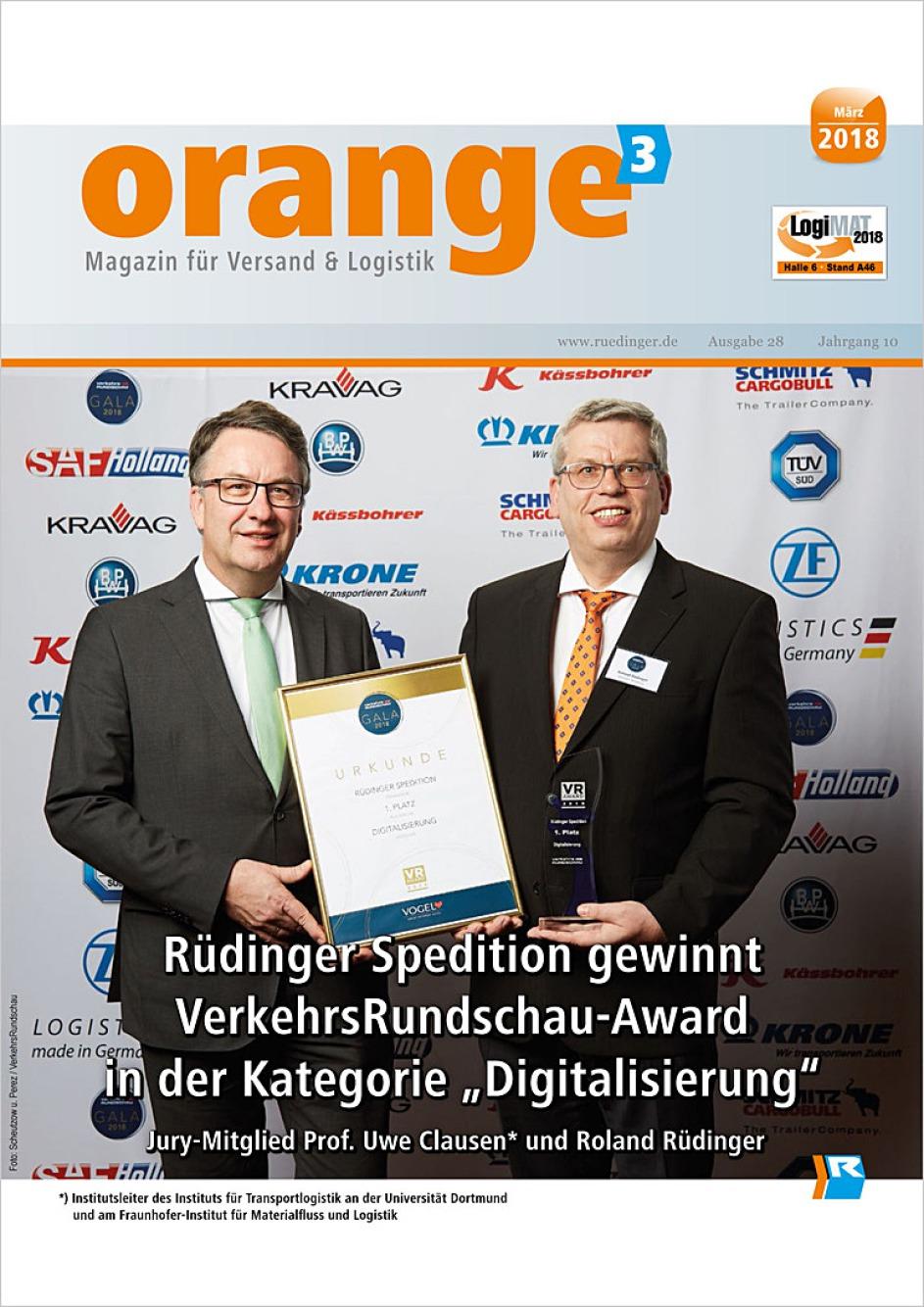 """Es ist die Titelseite der Rüdinger-Zeitschrift """"orange³"""". Man sieht den Button """"März 2018"""". Darunter sind in einem riesigen Bild zwei Personen abgebildet, die gemeinsam eine Urkunde, den 1. Preis demonstrieren."""